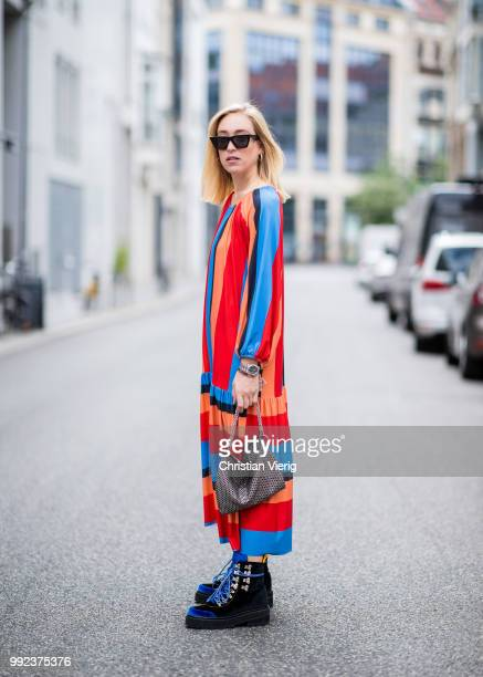 Sonia Lyson wearing multi color striped dress Zara bag Jimmy Choo tracking boots Blanca Miro x Edited is seen during the Berlin Fashion Week July...
