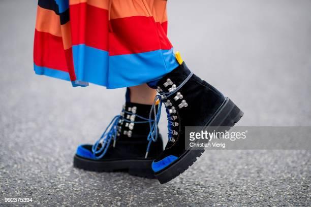 Sonia Lyson wearing multi color striped dress Zara bag Jimmy Choo tracking boots Blanca Miro x Edited is seen during the Berlin Fashion Week July...