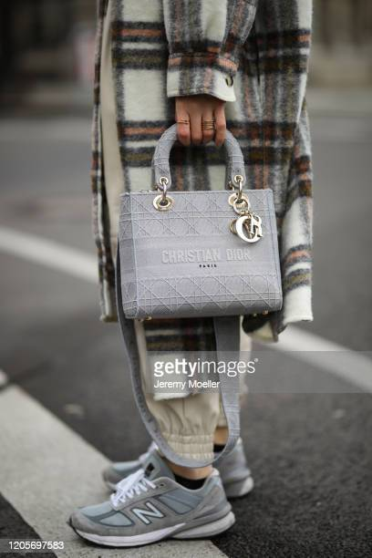 Sonia Lyson wearing New Balance sneaker Zara pants Edited sweater Ducie coat Acne Studios hat and Dior bag and shades on February 11 2020 in Berlin...
