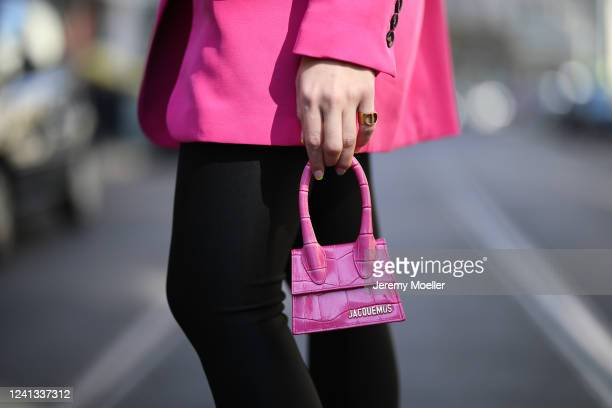 Sonia Lyson wearing &other stories pants, Zara blazer, Dior ring and Jacquemus mini pink bag on May 26, 2020 in Berlin, Germany.