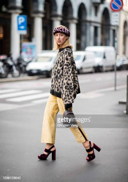 Sonia Lyson wearing pants backpack and head band Moncler shoes Kurt Geiger sweater with animal print other stories is seen during Milan Fashion Week...