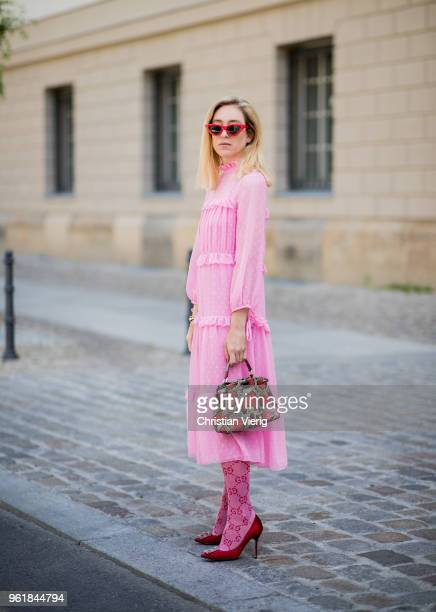 Sonia Lyson wearing pink ruffled dress Topshop Gucci knee socks pink Manolo Blahnik shoes Fendi bag Zara sunglasses on May 23 2018 in Berlin Germany