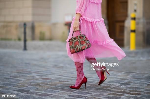 Sonia Lyson wearing pink ruffled dress Topshop Gucci knee socks pink Manolo Blahnik shoes Fendi bag Zara sunglasses on May 23 2018 in Berlin Germany