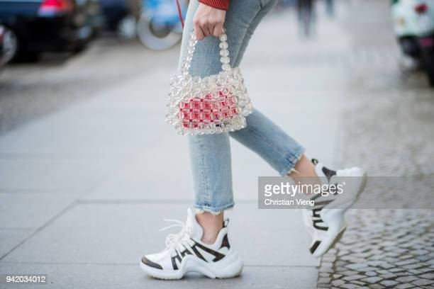 Sonia Lyson wearing red cropped bomber leather jacket Mango Agolde denim jeans white Louis Vuitton sneakers transparent see through pearl bag Mango...