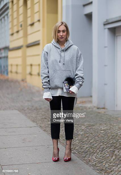 Sonia Lyson wearing red heel pumps manolo blahnik, black cropped denim jeans Zara, grey hoody weekday white blouse weekday, white Furla bag, black...