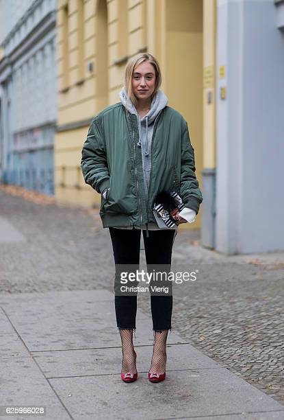 Sonia Lyson wearing red heel pumps manolo blahnik black cropped denim jeans Zara grey hoody weekday white blouse weekday khaki bomber jacket weekday...