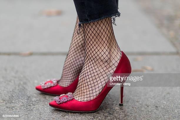 Sonia Lyson wearing red heel pumps manolo blahnik black net tights falke on November 26 2016 in Berlin Germany