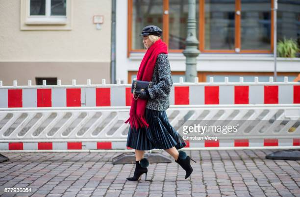 Sonia Lyson wearing red scarf black leather vintage hat black ankle boots with fur Jimmy Choo black Chanel bag pleated midi skirt zara grey knit Zara...