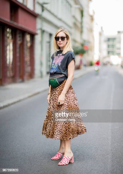 Sonia Lyson wearing red white striped mules Edited midi plaid skirt with leo print other stories tshirt with galaxy print Zara Dior sunglasses Dior...