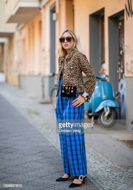 Sonia Lyson wearing Roger Vivier mules shoes blue checked wide leg pants Zara black vneck tshirt Topshop leopard print jacket Jimmy Choo bag Dior...