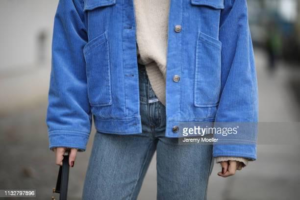 Sonia Lyson wearing Sandro shoes Closed jeans HM sweater Samsoe Samsoe jacket Chimy eyewear Dior bag on February 28 2019 in Berlin Germany