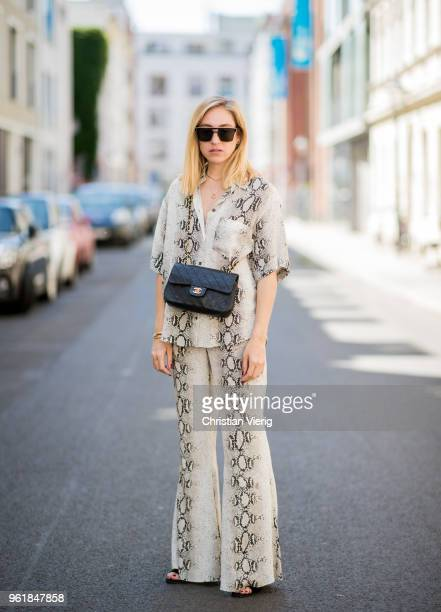 Sonia Lyson wearing snake print suit Zara Hugo by Hugo Boss shoes Chanel bag sunglasses and earrings Dior on May 23 2018 in Berlin Germany