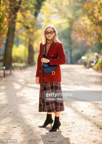 Sonia Lyson wearing tartan skirt red corduroy blazer brown turtleneck jumper sock boots Mango Dior saddle bag sunglasses on October 11 2018 in Berlin...