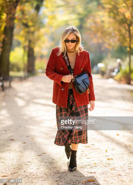 Sonia Lyson wearing tartan skirt red corduroy blazer brown turtleneck jumper sock boots Mango Dior saddle bag sunglasses on October 11 2018 in Berlin...