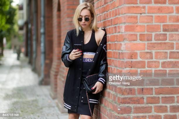 Sonia Lyson wearing Tommy Hilfiger rain jacket black skirt Chanel bag heels on September 4 2017 in Berlin Germany