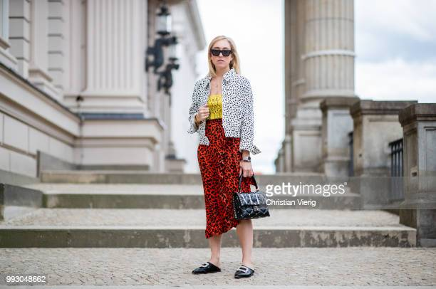Sonia Lyson wearing Topshop jacket top and skirt with animal print Valentino bag seen during the Berlin Fashion Week July 2018 on July 6 2018 in...