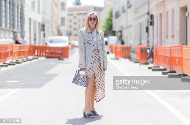 Sonia Lyson wearing velvet mules Raye via Revolve, plaid Topshop skirt with slit, tshirt Zoe Karssen, denim jacket Alexander Wang, MCM sunglasses, a...