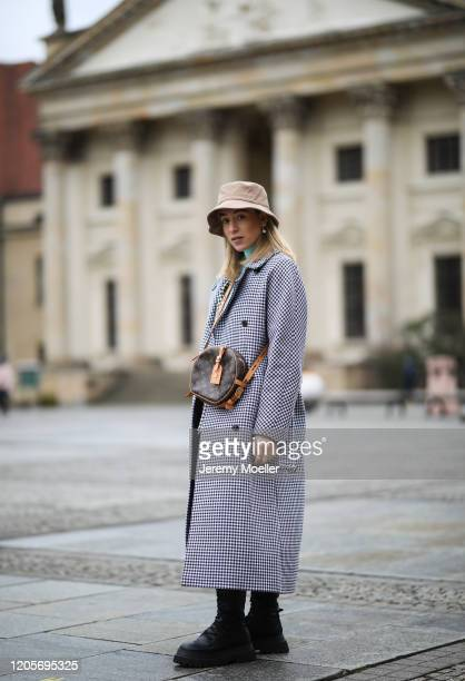 Sonia Lyson wearing Zara boots Anine Bing leather pants Closed coat other stories blazer and turtleneck and bucket hat and Louis Vuitton bag on...