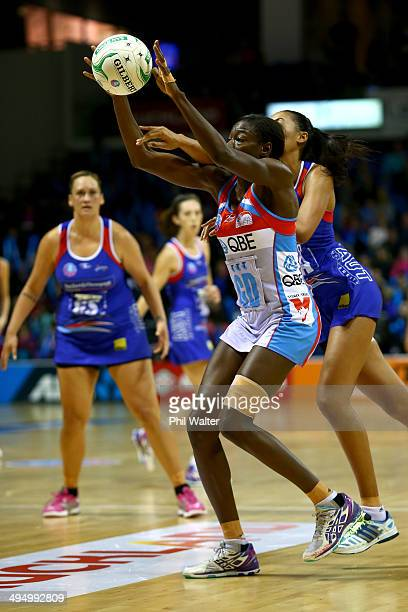 Sonia Mkoloma of the Swifts gets to the ball ahead of Maria Tutaia of the Mystics during the round 14 ANZ Championship match between the Mystics and...