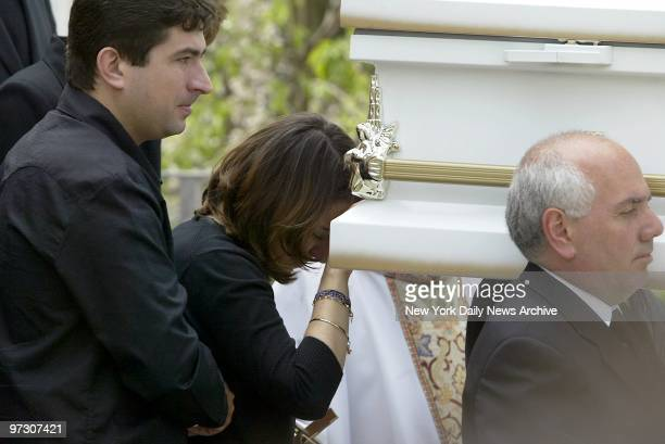Sonia Moura leans against the coffin of her daughter Gabrielle Acevedo as it is carried from St Margaret of Cortona Church in Riverdale the Bronx...