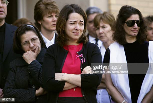 Sonia Moura stands with other family members outside St Margaret of Cortona Church in Riverdale the Bronx after funeral services for her daughter...