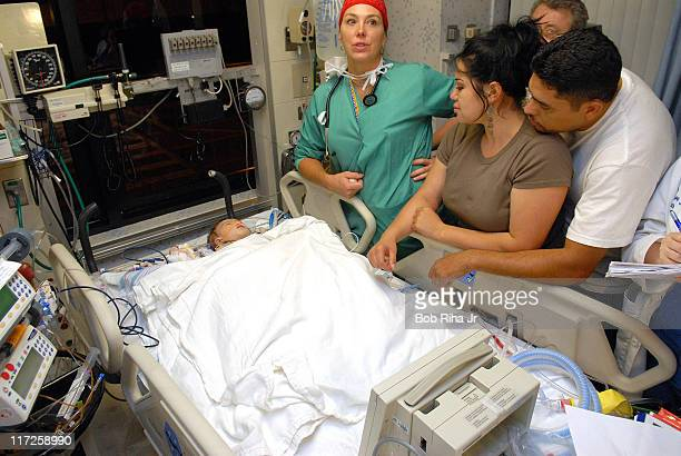 Sonia Salinas Fierros 23 and her husband Federico 36 from Mexico react after seeing their 10monthold former conjoined twin Regina moments after her...
