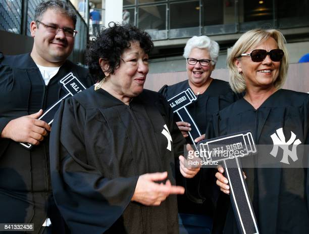 Sonia Sotomayor Associate Justice of the Supreme Court of the United States talks with fans in the 'Judge's Chambers' before a game between the...
