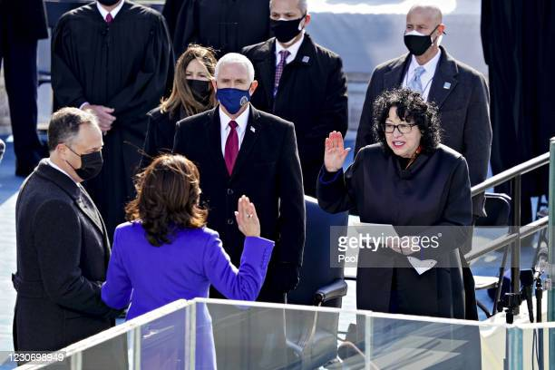 Sonia Sotomayor, associate justice of the U.S. Supreme Court, right, administers the oath of office to U..S. Vice President-elect Kamala Harris...