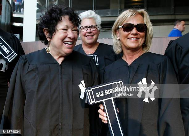 Sonia Sotomayor left Associate Justice of the Supreme Court of the United States with family and friends in the 'Judge's Chambers' before a game...