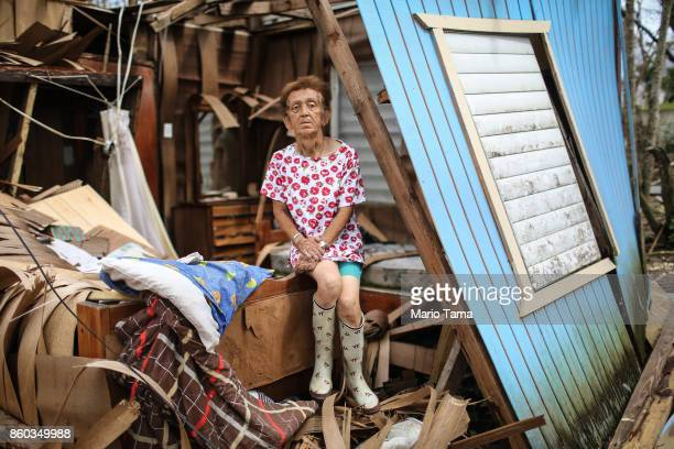 Sonia Torres poses in her destroyed home while taking a break from cleaning three weeks after Hurricane Maria hit the island on October 11 2017 in...