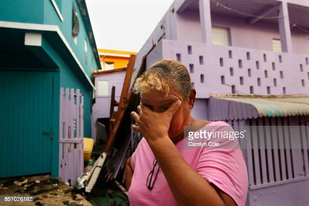 Sonia Viruet who lives in La Perla, Puerto Rico, takes stock after Hurricane Maria caused widespread damage on the island.