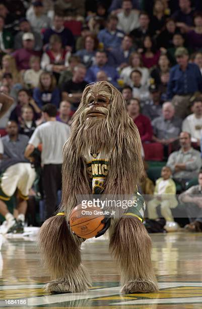 Sonic mascot Squatch entertains the crowd during the NBA game between the Houston Rockets and the Seattle Sonics at Key Arena on November 29 2002 in...