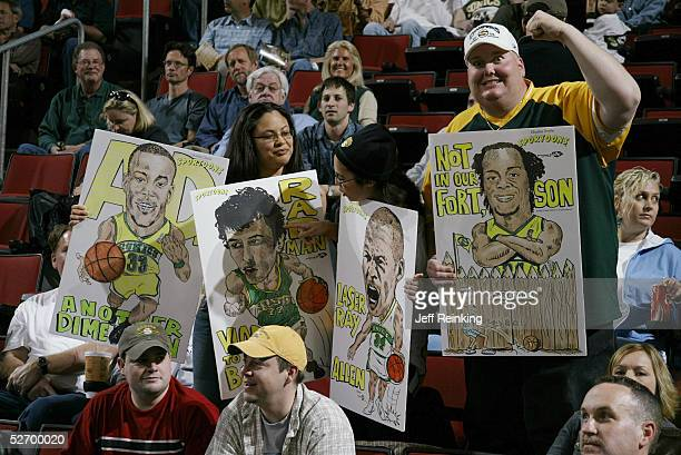 Sonics fans hold signs at the start of the game between the Seattle SuperSonics and the Sacramento Kings Game two of the Western Conference...