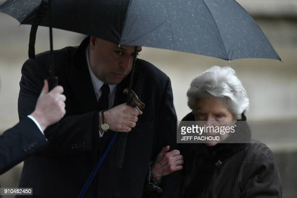 Soninlaw of late French chef Paul Bocuse Philippe Bernachon and French chef Paul Bocuse's widow Raymonde leave the SaintJean Cathedral in Lyon at the...