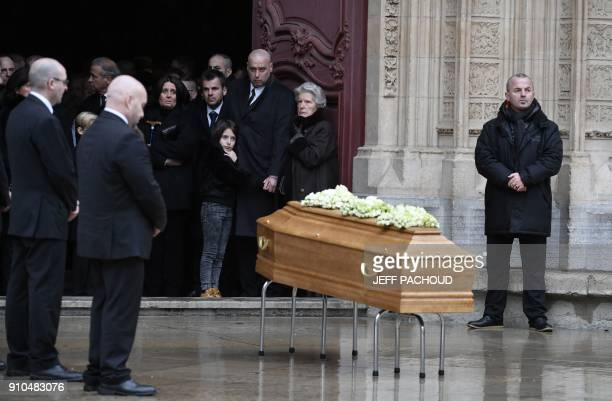 Soninlaw of late French chef Paul Bocuse Philippe Bernachon and French chef Paul Bocuse's widow Raymonde stand by the coffin of the late chef outside...