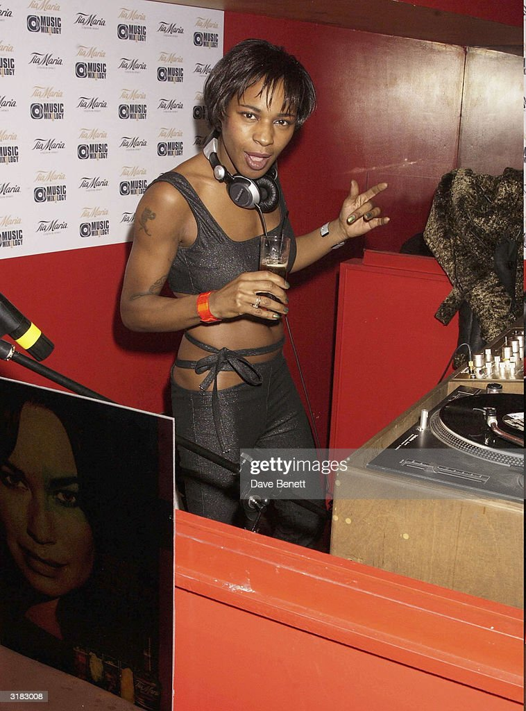 DJ Sonique at the mixing desk during the launch party for drinks company Tia Maria's promotion 'Tia Maria Mixology' on 27th November 2002 at the 'Click Club' on Wardour Street in the heart of Soho in London.