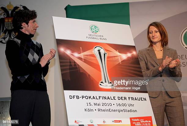 Sonja Fuss and Bettina Wiegmann present the official poster for the Women's DFB Cup Final 2010 during the German Football Association women trophy...