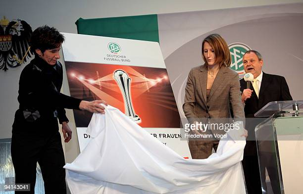 Sonja Fuss and Bettina Wiegmann present the oficial poster for the Women's DFB Cup Final 2010 during the German Football Association women trophy...
