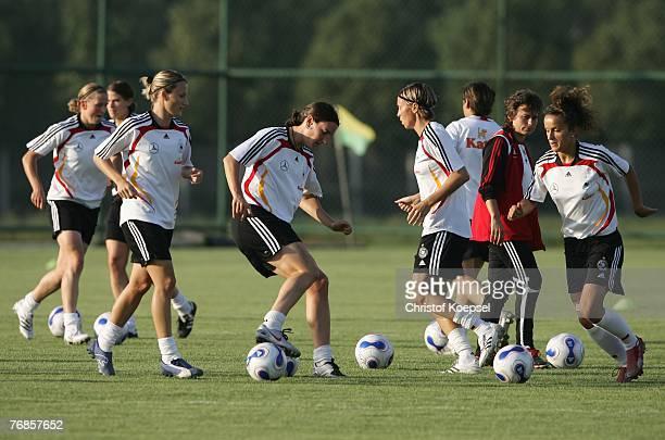 Sonja Fuss, Birgit Prinz, Sandra Minnert and Fatmire Bajramaj run with the ball during the Women's German National Team training session on the...