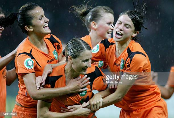Sonja Fuss celebrates with her Duisburg teammates after she scores the first goal for her team during the Women's DFB German Cup final between 1FFC...