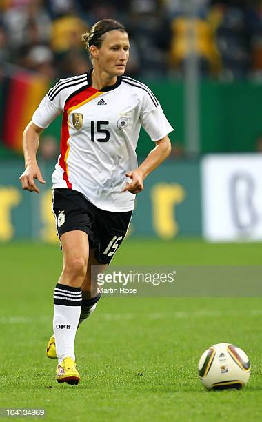 Sonja Fuss of Germany runs with the ball during the Women's International Friendly match between Germnay and Canada at Rudolf Harbig stadium on...