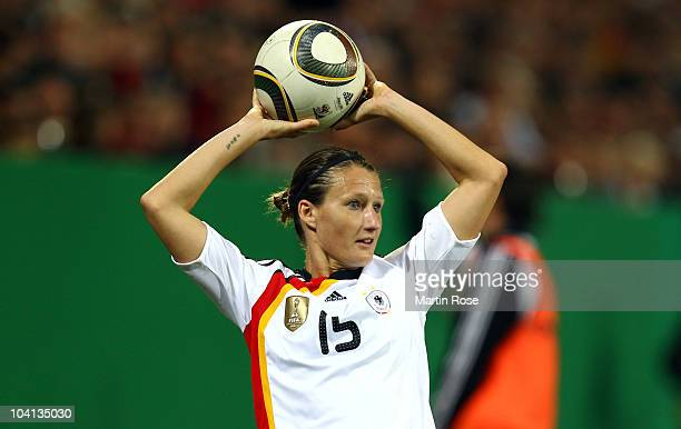 Sonja Fuss of Germany throws the ball during the Women's International Friendly match between Germnay and Canada at Rudolf Harbig stadium on...