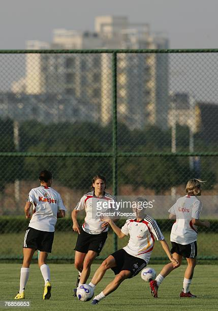 Sonja Fuss plays a ball during the Women's German National Team training session on the training ground at the Wuhan Sports Center Stadium on...