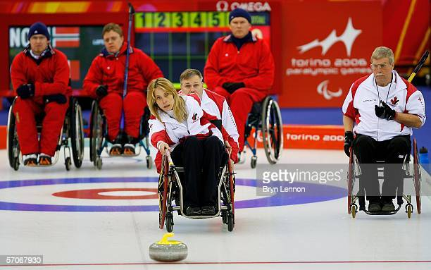 Sonja Gaudet of Canada releases the stone during Wheelchair Curling match between Norway and Canada on day three of the Turin 2006 Winter Paralympic...