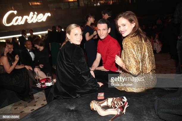 Sonja Gerhardt Sabin Tambrea and Emilia Schuele during the 'When the Ordinary becomes Precious #CartierParty Berlin' at Old Power Station on November...