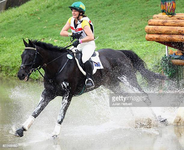 Sonja Johnson of Australia and Ringwould Jaguar go through the water jump during the Cross Country section of the Equestrian event at the Beas River...