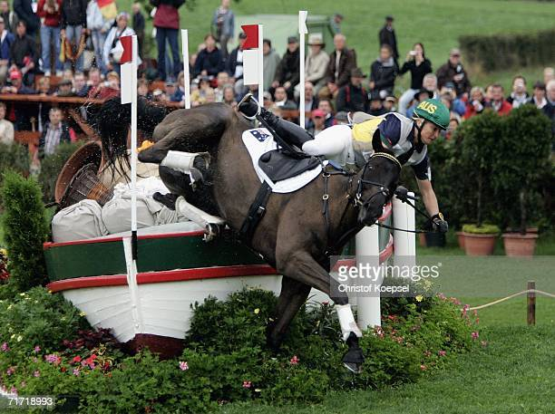 Sonja Johnson of Australia riding on Ringwould Jaguar falls during the Eventing Cross Country competition at the World Equestrian Games on August 26...
