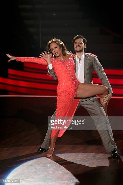 Sonja Kirchberger and Ilia Russo perform on stage during the 3rd show of the television competition 'Let's Dance' on April 1 2016 in Cologne Germany