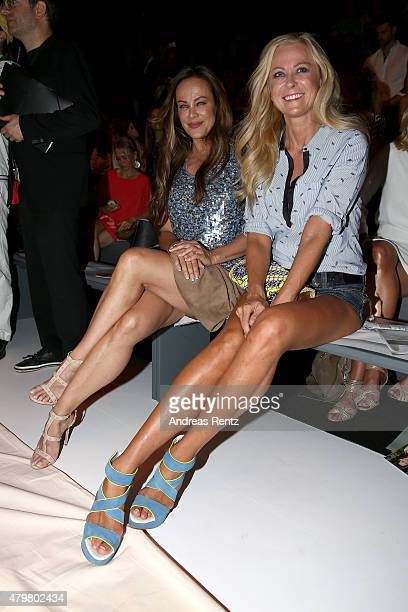 Sonja Kirchberger and Jenny Elvers attend the Riani show during the MercedesBenz Fashion Week Berlin Spring/Summer 2016 at Brandenburg Gate on July 7...