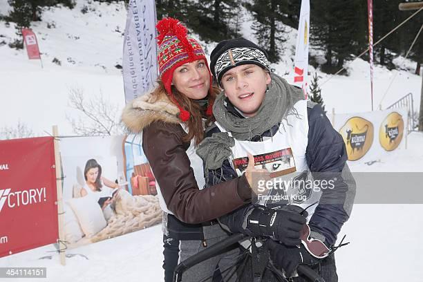 Sonja Kirchberger and LeeOscar Kirchberger attend the Sledge Dog Race Tirol Cross Mountain 2013 on December 07 2013 in Innsbruck Austria
